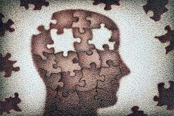 Símbolo de psicología Ibiza y neurociencias de una cabeza como un puzzle